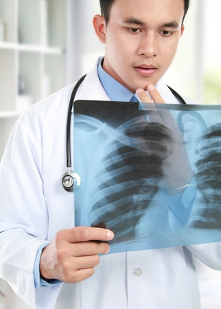 torax: close up potrait of doctor looking at chest x ray