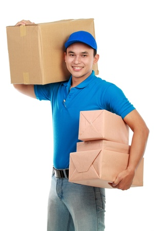 Young man courier in blue uniform with lots of packages isolated on white photo