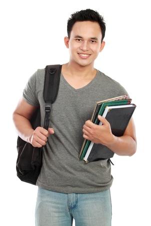 studenti universit�: Felice studente di college sorridente isolato su sfondo bianco