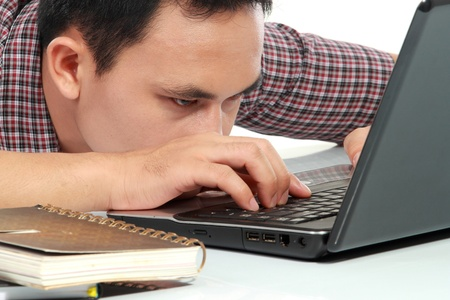 workaholic: Tired man with head down on laptop Stock Photo