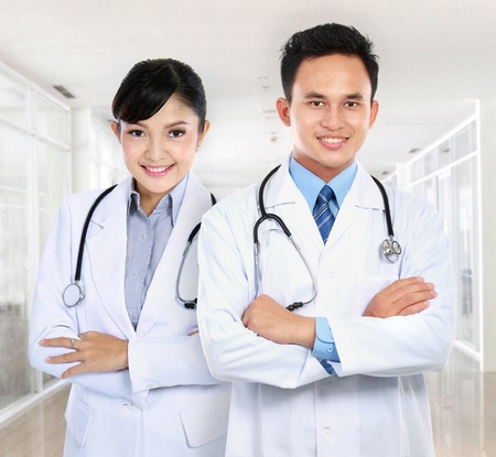 specialists: portrait of Smiling male and female medical doctor at the hospital Stock Photo