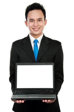 Smiling businessman showing a blank laptop against a white background Stock Photo - 12809722