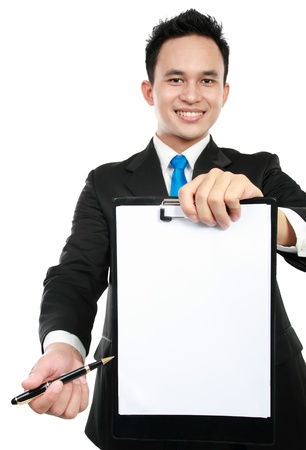 copyspace: smiling young business man showing blank clipboard, isolated on white background