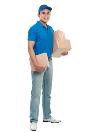 full body portrait of man courier in blue uniform with lots of packages isolated on white Stock Photo - 12809608