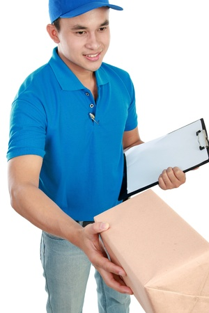 Young man courier in blue uniform giving the packages photo