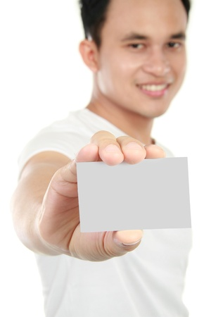 attractive young man showing blank card isolated on white background photo