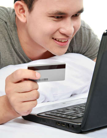 man purchasing product online, using credit card to pay Stock Photo - 12809766