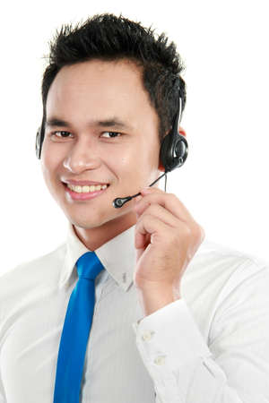 Closeup portrait of young call center operator using headset Stock Photo - 12809769