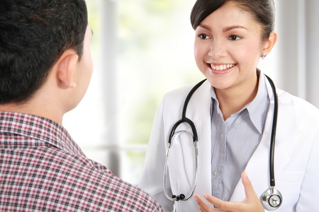 hospital patient: Doctor talking to a male patient at the hospital Stock Photo