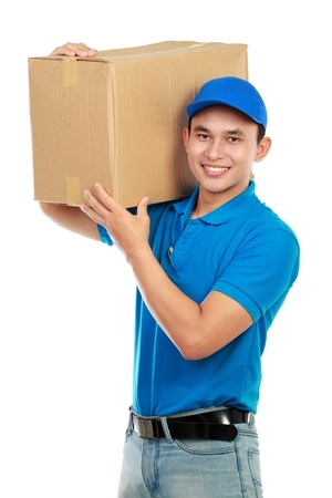 Young man delivery in blue uniform with packages isolated on white photo