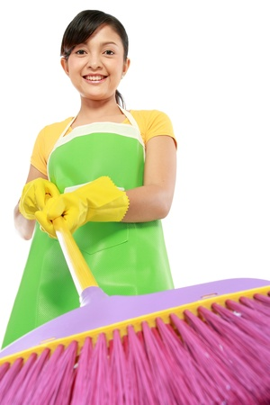 bright housekeeping: portrait of beautiful woman with cleaning sweep isolated over white background Stock Photo