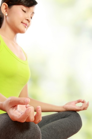portrait of healthy woman doing meditation photo