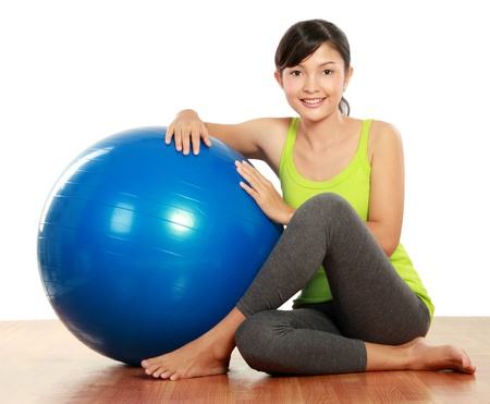 healthy fitness woman relaxing with pilates ball photo