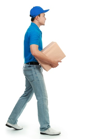 courier in blue uniform sending a package Stock Photo - 12809648