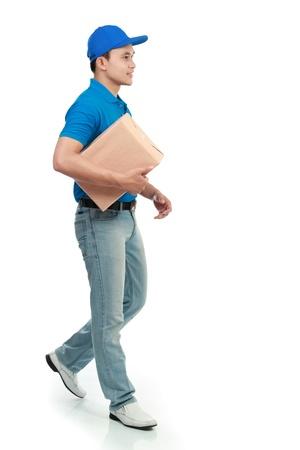 package sending: delivery man in blue uniform sending a package