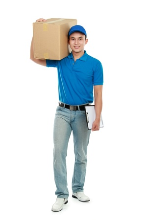 courier in blue uniform walking while carrying big package Stock Photo - 12809666