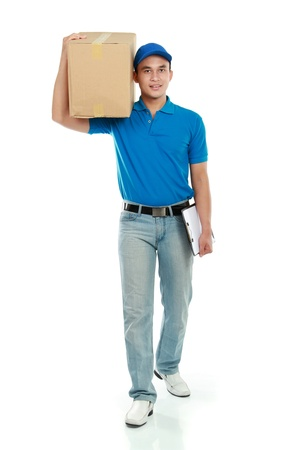 delivery service in blue uniform walking while carrying big package photo