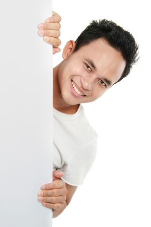 smiling man holding a blank billboard. isolated over white background photo