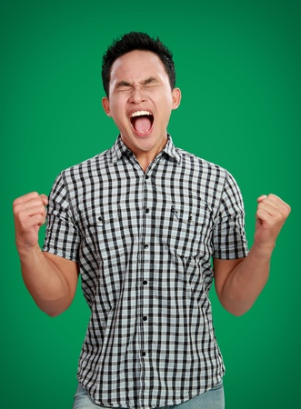 man screaming: portrait of stressed man expression on green background