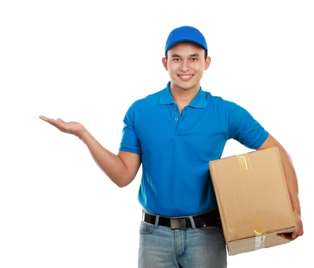 Portrait of smiling delivery man with package presenting something on white background photo