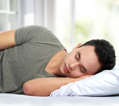 portrait of asian Man lying in bed sleeping Stock Photo