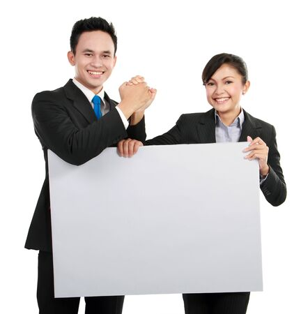 Portrait of young business team holding a big blank card for text photo