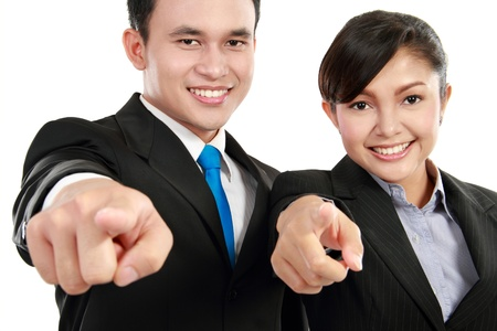 Portrait of a woman and man office worker pointing at you isolated on white background photo