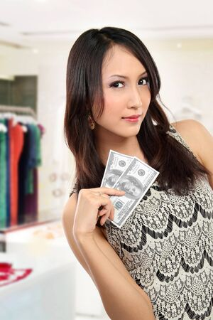 woman showing  money for shopping photo