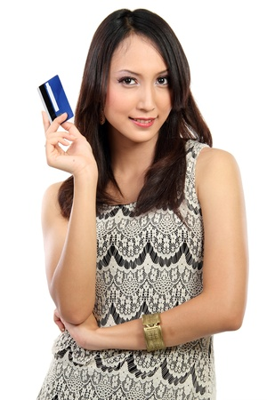 plastic money: portrait of young female holding credit card isolated on white background