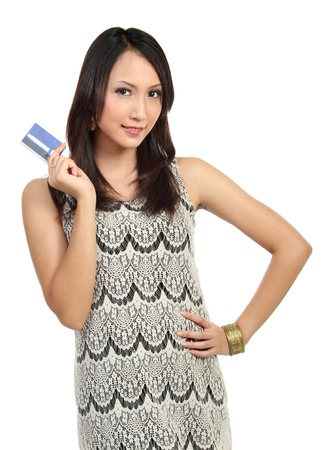 woman showing  credit card isolated on white background Stock Photo - 12991761