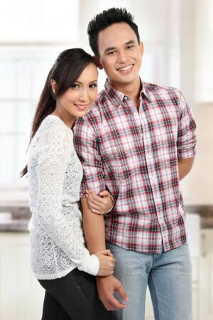 Portrait of a beautiful young happy couple smiling Stock Photo - 12991834