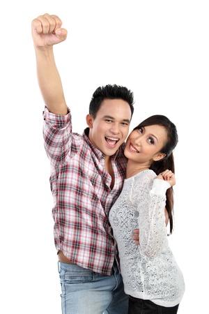 pareja saludable: Retrato de una hermosa joven pareja sonriente feliz aisladas sobre fondo blanco