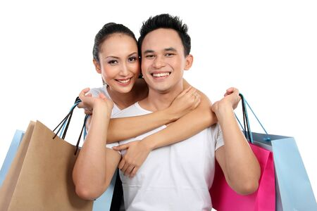 shopping man: beautiful young couple shopping. isolated over white background Stock Photo