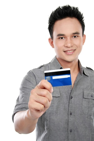 portrait of asian man showing credit card isolated on white background photo
