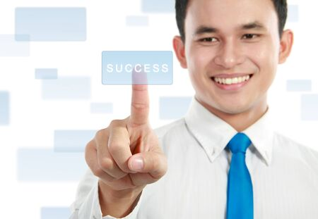 portrait of young businessman pressing success button on the screen photo