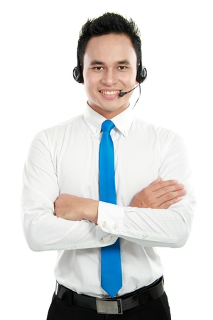Portrait of a successful asian customer service smiling against white background photo