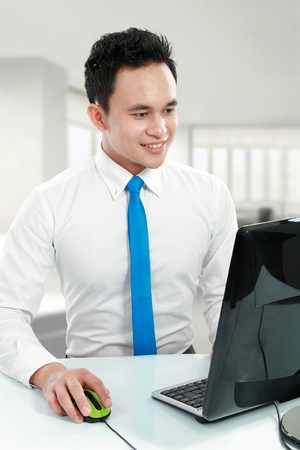 Portrait of a handsome young asian business man working in the office photo