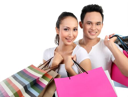 Romantic young couple shopping and holding many shopping bags Stock Photo - 13157472