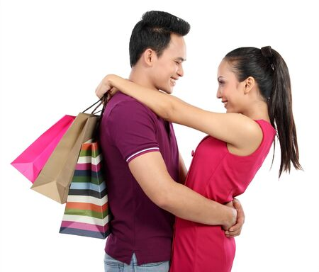 Romantic young couple shopping hug each other Stock Photo - 13157466