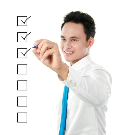 marking: businessman marking check boxes with marker