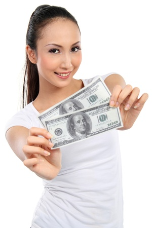 winning business woman: woman showing  money isolated on white background