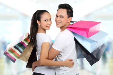 Romantic young couple shopping in the mall with many shopping bags Stock Photo - 13231449