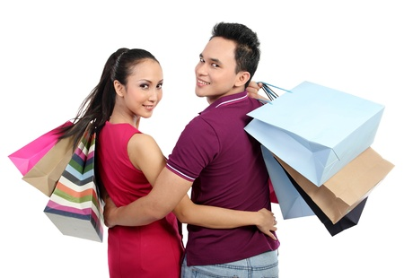 Romantic young couple shopping isolated on white background Stock Photo - 13231439