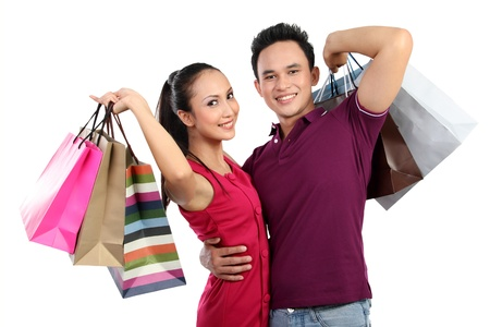 Romantic young couple shopping and holding many shopping bags photo