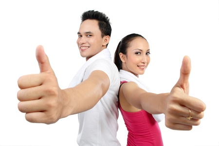 ok hand: portrait of fitness woman and man showing thumb up
