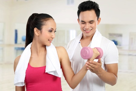 man and woman doing sport in the gym photo