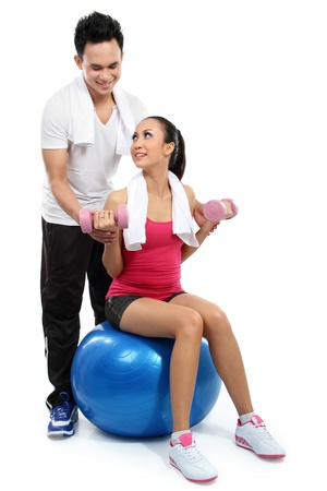 swiss ball: man and woman doing sport isolated over white background Stock Photo