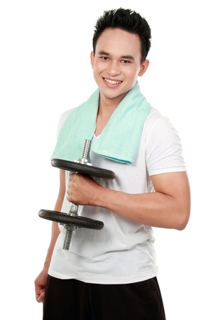 asian bodybuilder: portrait of a handsome young healthy sports man with dumbbell smiling looking at camera Stock Photo