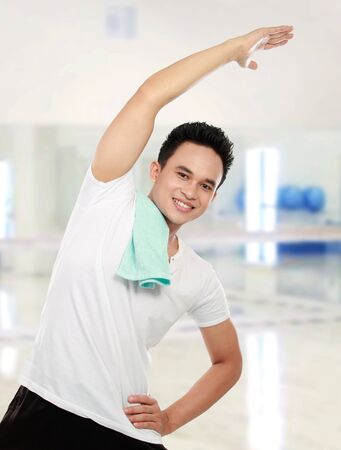 Young asian man stretching in the gym Stock Photo - 13231406