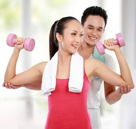 asian bodybuilder: man and woman doing sport in the gym Stock Photo